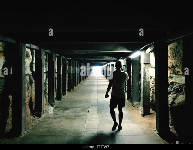 Rear View Of Man Walking At Colonnade - Stock Image