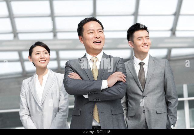 Portrait of business team at the airport - Stock Image