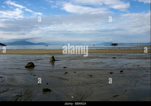 Serene beach scene from near boat dock Gustavus Alaska USA - Stock Image