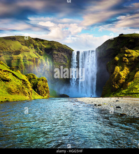 Colorful summer scene with pure water of Skogafoss Waterfall. Sunny morning on the Skoga river, south of Iceland, - Stock Image