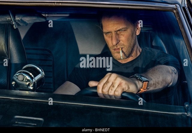 smoking driving car stock photos smoking driving car stock images alamy. Black Bedroom Furniture Sets. Home Design Ideas