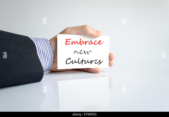 Embrace new cultures text concept isolated over white background - Stock-Bilder