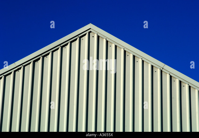 Exterior Closeup View Of A Modern Corrugated  Industrial Building. - Stock Image