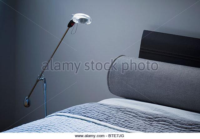 Detail modern floor lamp beside bed - Stock-Bilder