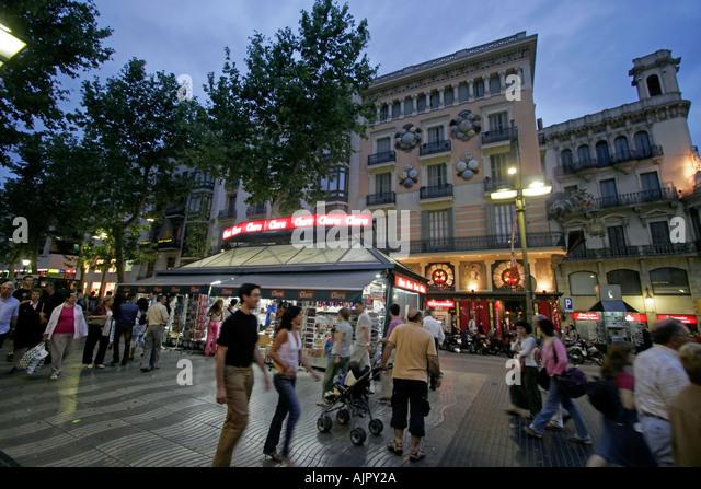 Spain Barcelona Las Ramblas dusk tourists - Stock Image