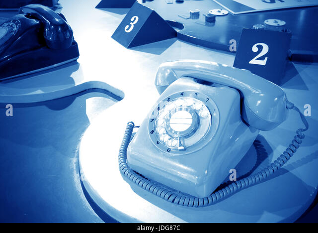 Sixties vintage, rotary dial telephones. - Stock Image
