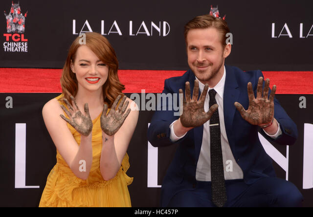 Hollywood, Ca. 7th Dec, 2016. Emma Stone and Ryan Gosling at the Emma Stone and Ryan Gosling Hand and Foot Print - Stock Image