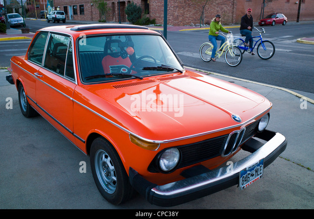 Old BMW sports car, painted orange & black in honor of the Philadelphia Flyers National Hockey Team - Stock Image