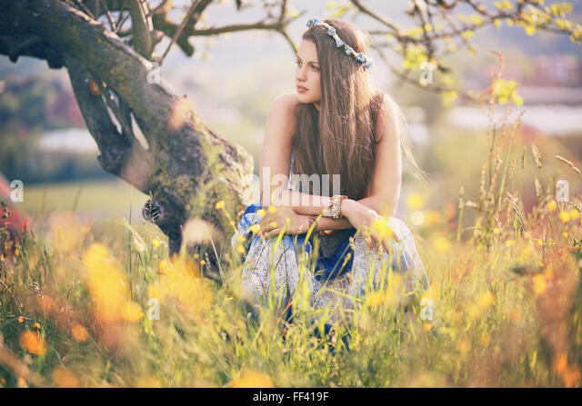 Beautiful hippie woman with summer flowers. Peace and harmony - Stock-Bilder