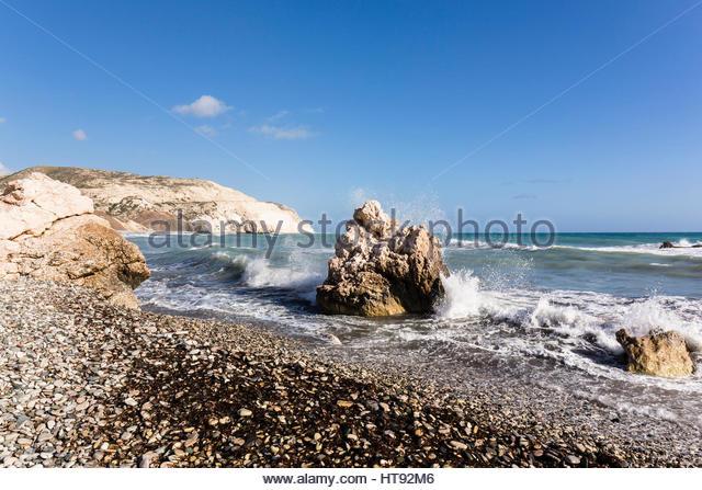 Surf on Shoreline at Petra tou Romiou, Paphos, Cyprus - Stock Image