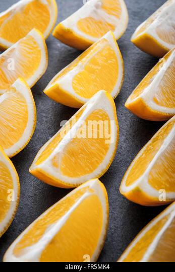 Yellow lemons on a blue stone table horizontal - Stock Image