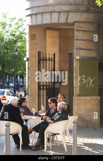 restaurant terrace people drinking wine civb le bar a vin allees tourny bordeaux france - Stock Image