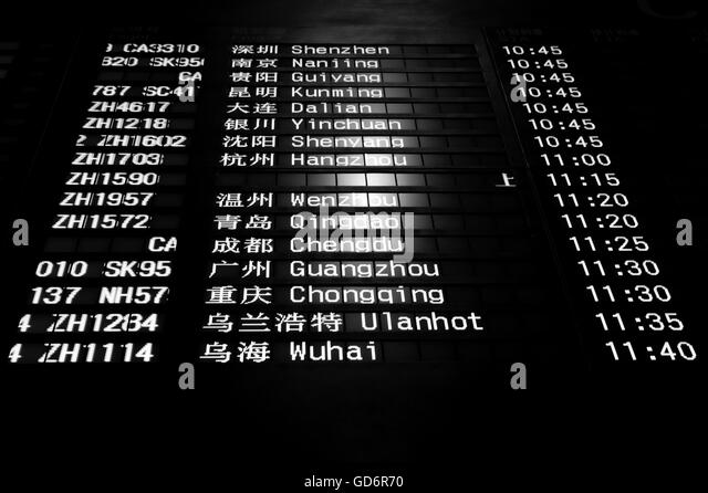 Low Angle View Of Arrival Departure Board In Airport - Stock Image