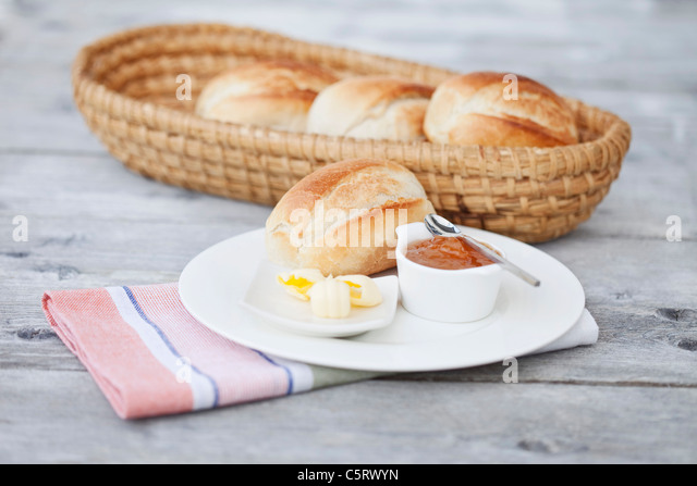 Germany, Close up of bread rolls with butter and jam - Stock Image