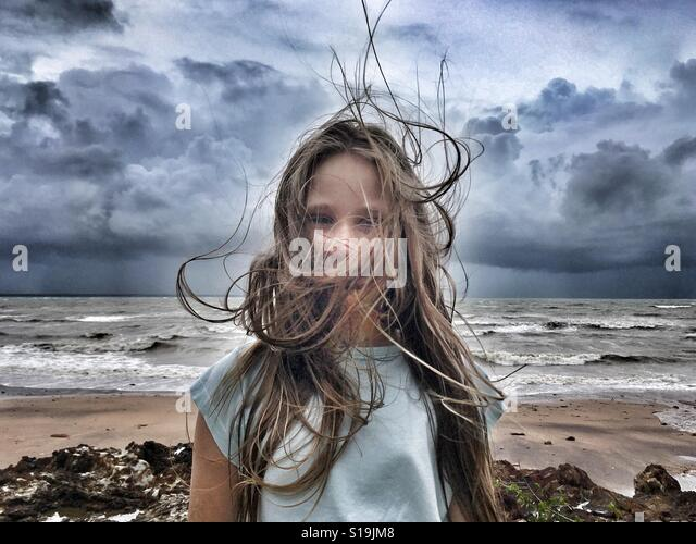 Young girl in the wind. - Stock Image