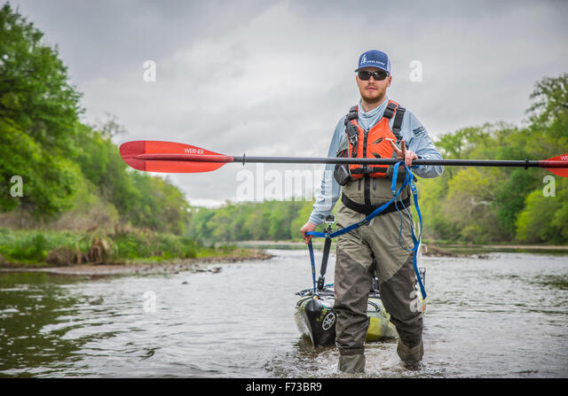 Angler Throws Up Peace Sign While Dragging on the Brazos River in Texas - Stock-Bilder