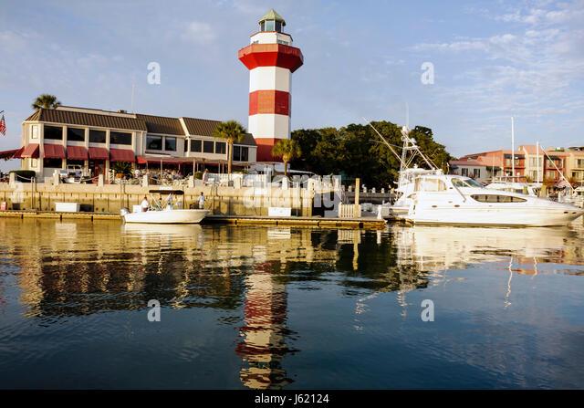 South Carolina Hilton Head Island Sea Pines Plantation South Beach Harbour Town resort lighthouse red white striped - Stock Image