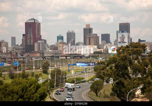Skyline and highway, Johannesburg, Gauteng, South Africa - Stock Image