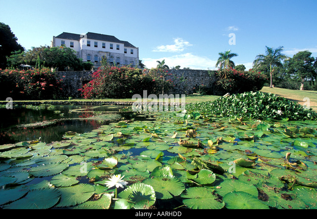 Jamaica Rose Hall Great House Montego Bay with lily pond in front - Stock Image