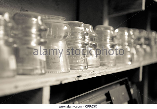 Shelf lined with antique glass insulators, Neal Antique Store, Sept. 10, 2011 - Stock Image