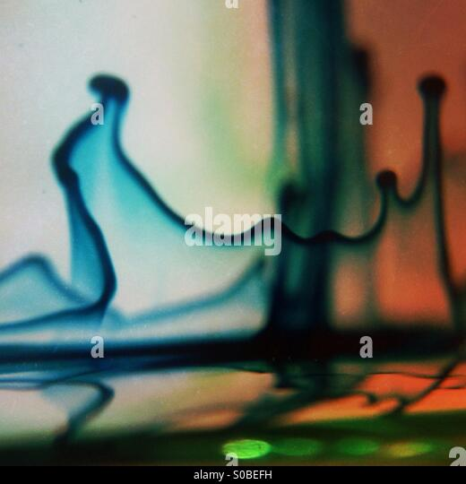 Movement of dye in water - Stock Image