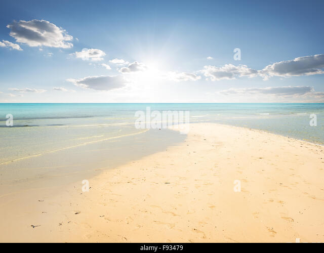 Sand beach and turquoise water in lagoon - Stock Image