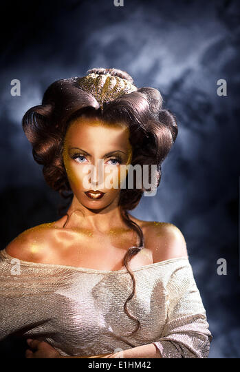 Coloring. Portrait of Styled Woman with Golden Colored Skin - Stock Image