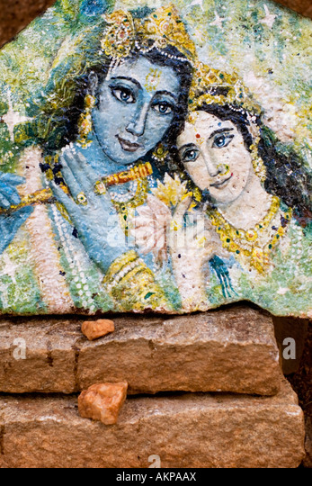 Krishna and Radha painted on a stone. Andhra Pradesh, India - Stock Image