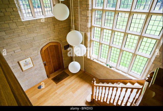 Looking down into the entrance hall of a modern contemporary English country house manor or mansion in the UK - Stock Image