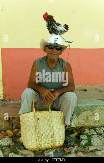Man with Rooster, Trinidad, Cuba - Stock Image