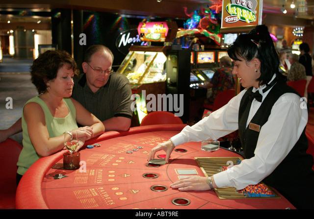 BVI Tortola Holland America Caribbean cruise from New York ms Noordam casino couple black jack dealer gambling - Stock Image