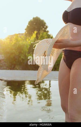 woman's body at a natural pool - Stock Image