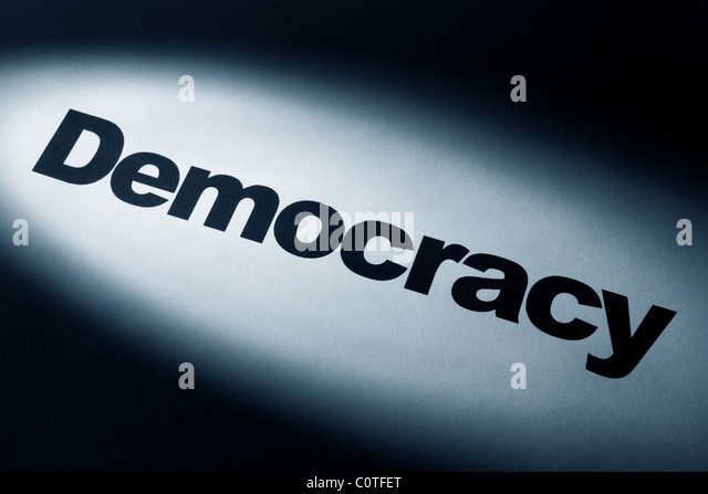 light and word of Democracy Change for background - Stock Image