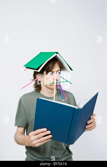 Bizarre man reading a book - Stock Image
