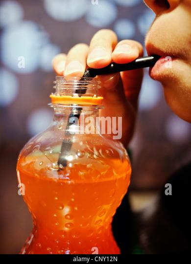 Boy, straw, orange soda. - Stock-Bilder