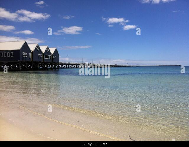 wood jetty and buildings on the ocean - Stock Image