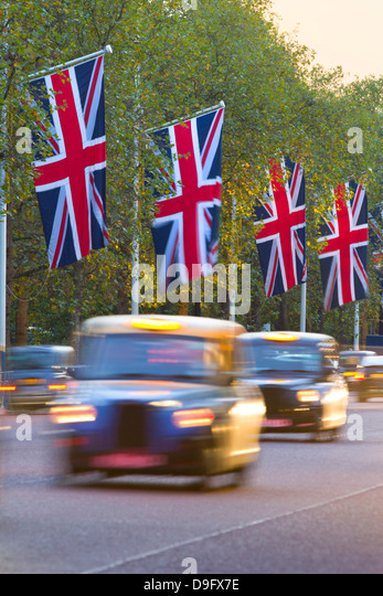Black cabs along The Mall with Union Jack flags, London, England, UK - Stock-Bilder
