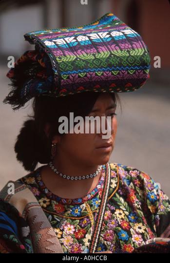 Guatemala La Antigua colonial capitol until earthquake Cakchiquel Indigenous woman handicrafts - Stock Image