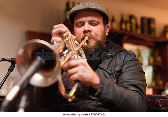 Trumpet player playing into microphone - Stock Image
