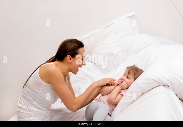 Family at home in bedroom - Stock Image