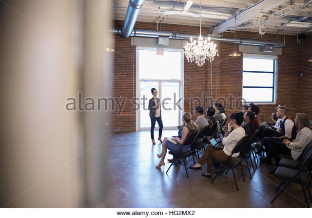 Businesswoman leading conference meeting - Stock Image