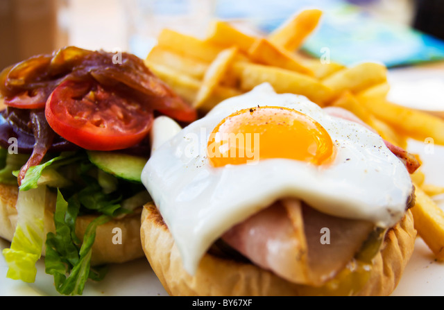 beef wagyu burger with chips, bacon, ham, egg,  and vegetables - Stock Image