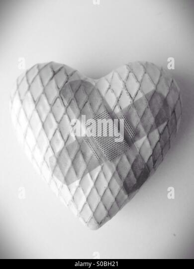 A heart with bandaids. - Stock Image