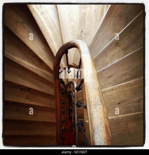 A curvy wooden staircase - Stock Image