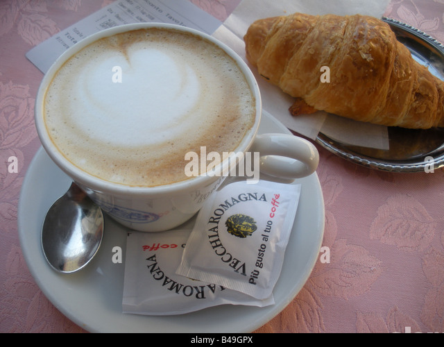 cappuccino-and-croissant-served-on-pink-