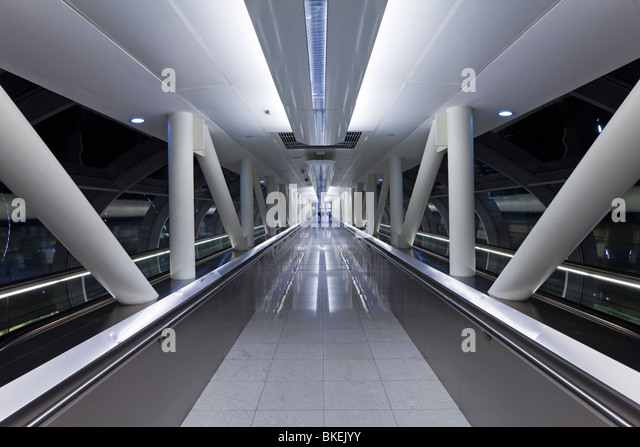 Walkway in the stylish 2010 opened Terminal 3 of Dubai International Airport, Dubai, UAE, United Arab Emirates - Stock Image