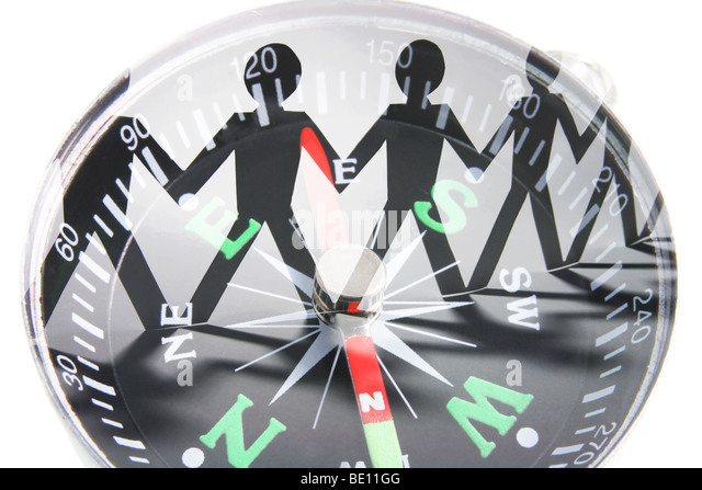 Paper Cutout Dolls and Compass - Stock Image