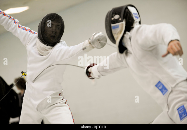 Aspiring members of the UK fencing team take part in a fencing competition, Morden, 28 November 2009. - Stock Image