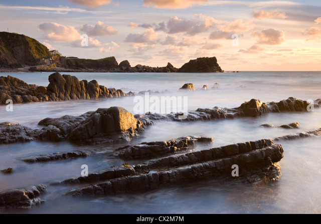 Late evening sunshine glistens on the wet rocks at Hartland Quay, North Devon, England. Autumn (September) 2010. - Stock Image