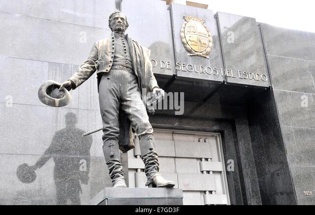 José Artigas statue before the Banco De Seguros Del Estato Montevideo Uruguay - Stock Image